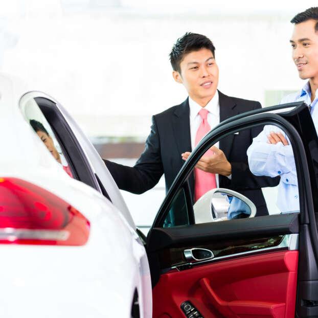 Asian car sales man and customer