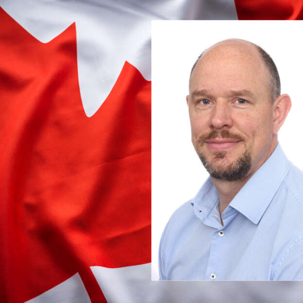 Person in front of Canadian flag